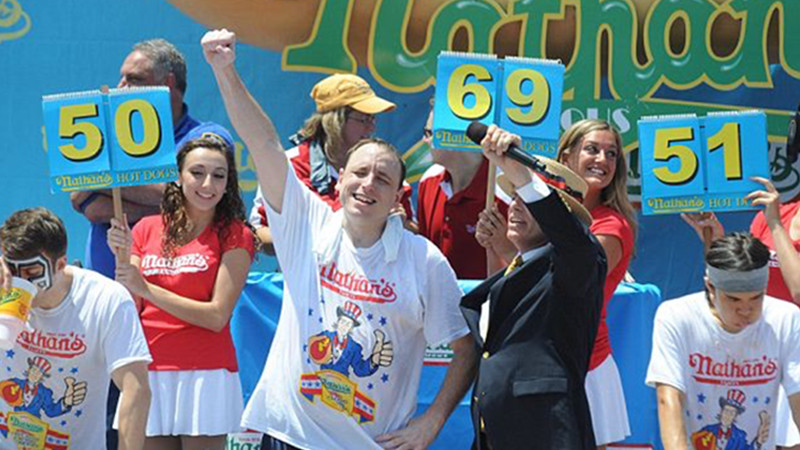 Joey Chestnut setting a new record of 69 hot dogs